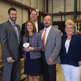 World Energy Efficiency Service, Lt. Gov. Polito Holding a Lightbulb